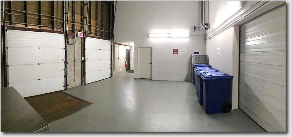 Looking toward warehouse lease space internal man-door